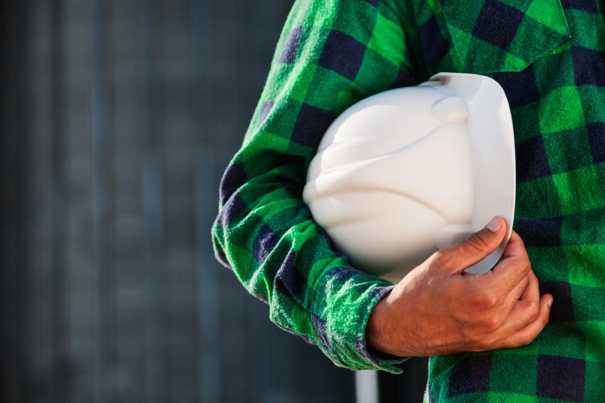 Engineer holding protective helmet